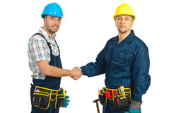 Constructors workers hand shake. Two mid adults constructors workers giving hand shake isolated on white background Stock Photography