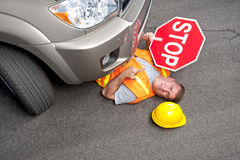 Constructure worker hit by car. A construction road worker is injurd by a car that didn't stop Stock Photo