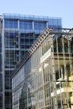 Construções novas com o céu azul no fundo Fotografia de Stock Royalty Free