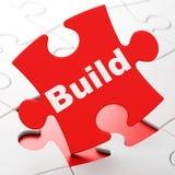 Construindo o conceito: Construção no fundo do enigma Foto de Stock Royalty Free