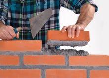 Construindo uma parede. Fotos de Stock