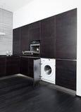 Construire-dans la machine à laver et le cuiseur Photographie stock libre de droits