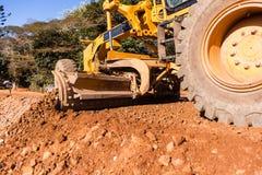 Construção de estradas das terraplenagens do graduador Imagem de Stock