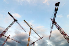 Construstion site with tower cranes against blue sky Royalty Free Stock Photos