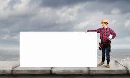 Construtor com bandeira Imagem de Stock Royalty Free
