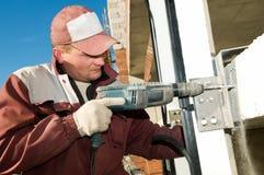 Construtor com broca Foto de Stock