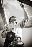 Construtor com guincho Foto de Stock Royalty Free