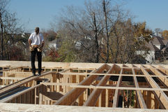 Construtor da construção no local imagem de stock