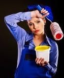 Construtor da mulher com latas da pintura. Imagens de Stock