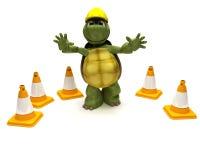 Construtor da tartaruga com cones do perigo Imagem de Stock Royalty Free