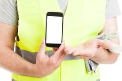 Construtor do close-up que apresenta o telefone celular com exposição vazia Imagens de Stock