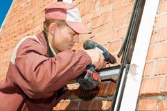 Construtor do trabalhador com chave de fenda Fotos de Stock