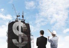 Construtor e arranha-céus com dólar Fotografia de Stock