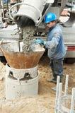 Construtor no construcrion da pilha Imagem de Stock