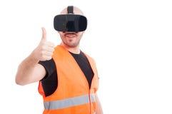 Construtor novo alegre que mostra o polegar acima Fotos de Stock Royalty Free