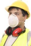 Construtor ou carpinteiro com máscara protectora imagem de stock