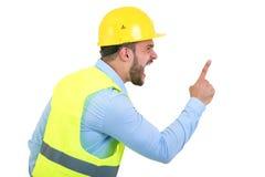 Construtor ou construtor irritado que gritam em alguém como o conceito da fúria isolado no fundo branco com copyspace fotografia de stock royalty free