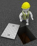 Construtor que inspeciona drenos através da tampa de câmara de visita Foto de Stock Royalty Free