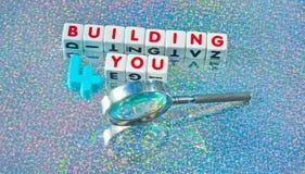 Construyendo 4 usted Foto de archivo