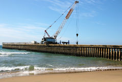 Constuction of New Concrete Pier on Beach Royalty Free Stock Image