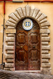 Consulaat van Griekenland Oude houten deur stock afbeelding