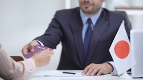Consular officer of Japan giving passport to woman, approved tourist visa. Stock footage stock video footage