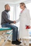 Consulta com um doutor Imagens de Stock Royalty Free