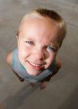 Consulta ereta da criança acima Imagem de Stock
