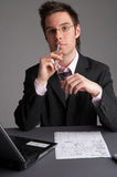 Consultancy. Businessman with notebook and a sheet of paper Stock Image