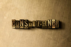 CONSULTANCY - close-up of grungy vintage typeset word on metal backdrop Royalty Free Stock Images