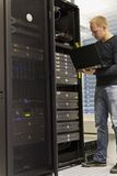 IT Consultant. IT Engineer / Consultant working and monitoring systems and servers in a datacenter Royalty Free Stock Photo