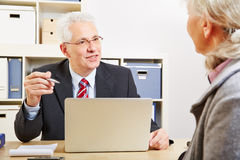 Consultant in bank making financial. Proposal to senior customer Stock Photography