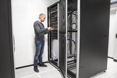 IT consultant building network rack in datacenter Stock Images
