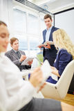 Consultant in a business meeting. And consults business people Royalty Free Stock Images