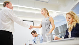 Consultant and business woman shake hands Royalty Free Stock Image