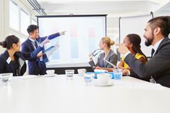 Consultant in business workshop presentation. Discussing ideas and solutions royalty free stock photos
