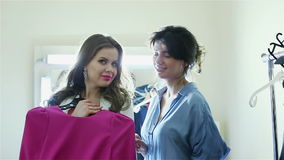 Consultant and buyer in the women's clothing store. stock video footage