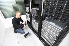 IT consultant calling for help in datacenter Royalty Free Stock Photography