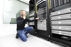 IT consultant calling support in datacenter Stock Photos