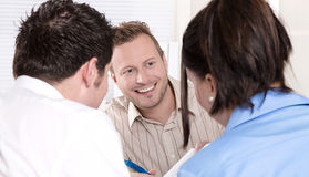 Consultant with a couple at office. Stock Photo