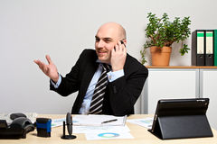 Consultant discusses the sales figures with a customer Royalty Free Stock Photo