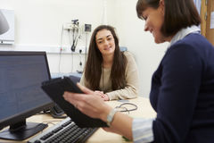 Consultant Discussing Test Results With Patient Stock Images