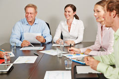 Consultant giving advice to business people Stock Photo
