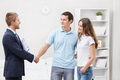 Consultant at home. The consultant shakes hands with a man Royalty Free Stock Images