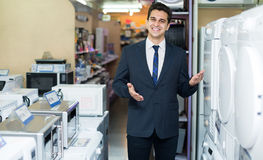 Consultant at household appliances section Royalty Free Stock Image