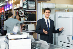 Consultant at household appliances section Stock Photography
