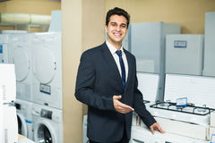 Consultant at household appliances section Royalty Free Stock Images