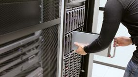 IT consultant install blade server in cluster at datacenter