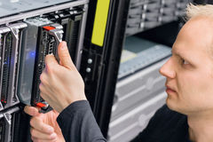 It consultant install blade server in datacenter Stock Image