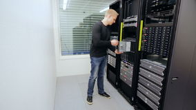 It consultant install blade server in datacenter stock video